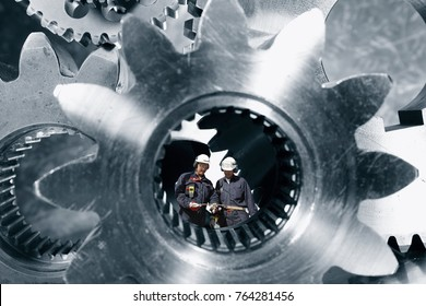 Industry-workers, engineers standing inside a giant steel shaft, steel industrial concept