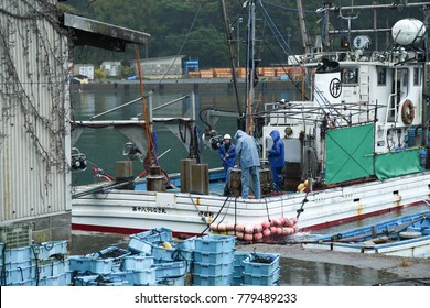 INE KYOTO, JAPAN NOVEMBER 30, 2017 : Fishermen are going out to fish on a rainy day at Ine Boathouse of Kyoto of JAPAN.