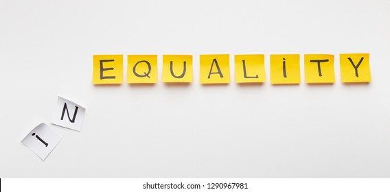 Inequality at corporate world. Word Equality written on yellow office stickers with particle In on white background, panorama