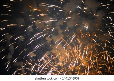 Inexpensive fireworks, over the city, white and yellow. For any purpose.