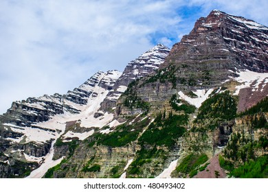 Infamous Maroon Bells massive Rock Faces near Aspen Colorado taken in June on a Hiking trip into the Elk Mountain Rang of the Rocky Mountains the North and South Maroon Bell Peak reaches 14,000 Feet