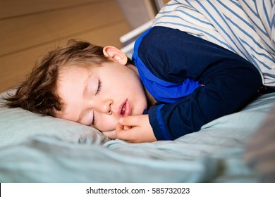 Infant baby boy kid sleeping in bed. Sweet dreams. Toddler taking a tap.