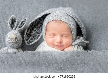 Infant baby boy sleeping under blanket