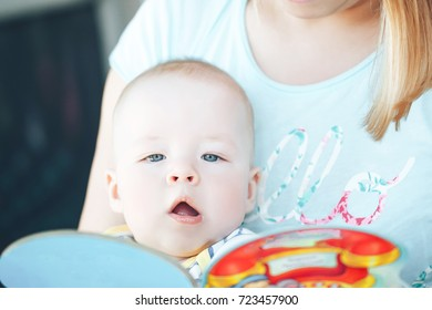 Infant Baby Child Boy Six Months Old is Reading