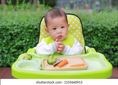Infant baby eating by Baby Led Weaning (BLW). Finger foods concept.