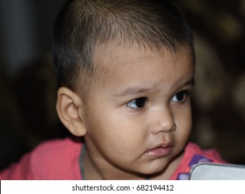 Infant baby girl closeup image with natural pose.