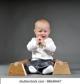 Infant boy with gymnastic P-bars