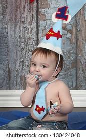 Infant boy's first birthday cake smash Adorable baby smashing cake