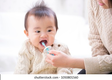 Infant to brush teeth
