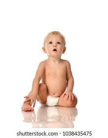 Infant child baby boy toddler sitting naked in diaper looking up isolated on a white background