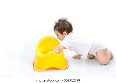 Infant child baby boy toddler play with potty toilet stool pot a white background