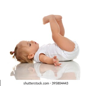 Infant child baby girl in diaper lying on a back and looking up isolated on a white background
