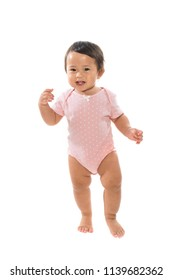 Infant child baby girl kid make first steps isolated on a white background