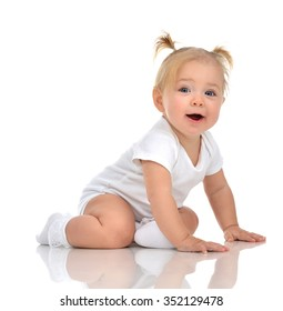 Infant child baby girl toddler crawling happy looking straight isolated on a white background