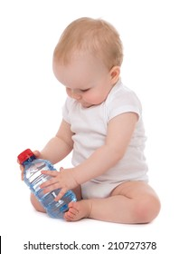 Infant child baby sitting with bottle of drinking water in diaper isolated on white background