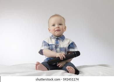 An infant child with karaoke microphone