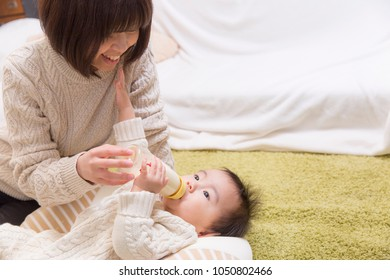 Infant drinking milk