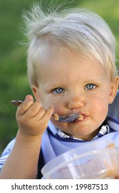 Infant eating dinner with a spoon