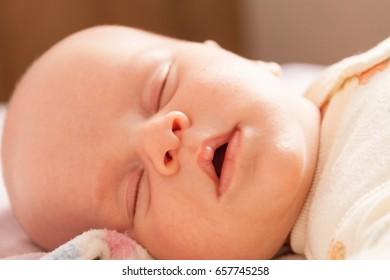 Infant face close up. Family concept. Body part. Pregnancy