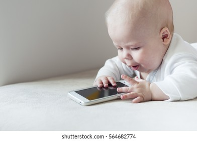 Infant fascinated with cell phone