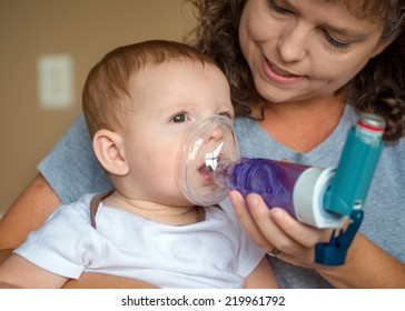 Infant getting breathing treatment from mother while suffering from illness