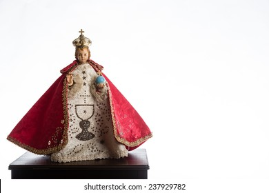 Infant Jesus of Prague in red vestments on a white background