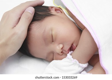 infant sleeping on white bed after drink milk