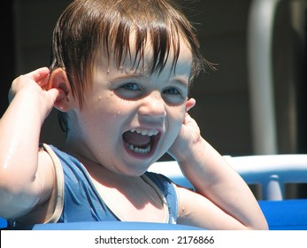Infant Swimmer in Pool Laughing