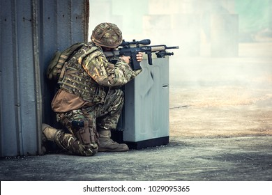 Infantry soldier of the elite special purpose unit shooting during military combat the battle in war. The army weapon technology concept with space for advertising text.