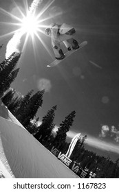 Infared image of pro snowboarder in superpipe competition