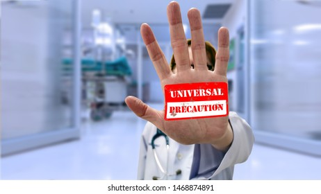 Infectious disease doctor 's hand alert of universal precaution with blurred background of hospital. Universal precaution is avoiding contact patient's fluid to prevent infection. HIV control concept