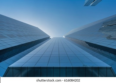 Infinite Corporate Buildings. Business offices skyscrapers on blue sky background. Low angle view of tall corporate buildings.