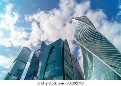 Infinite Corporate Buildings. Business offices skyscrapers on blue sky background.