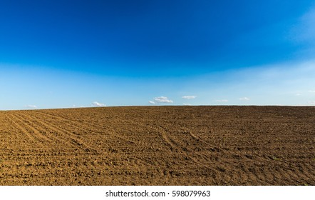 Infinite horizon abstract composition with rural fields in spring