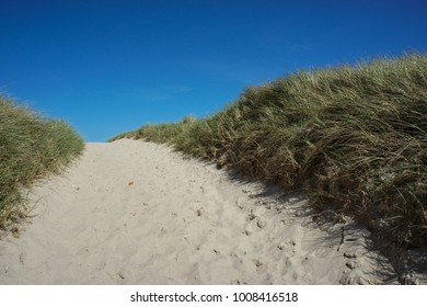 Infinitely view through the dunes with blue sky