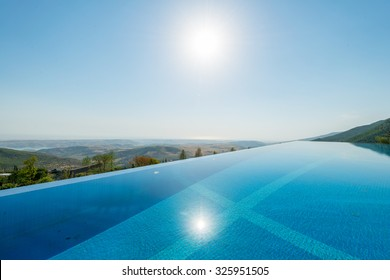 Infinity pool on the bright summer day
