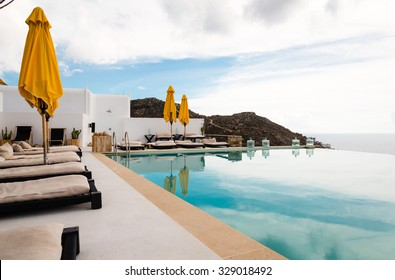 infinity pool with yellow umbrellas