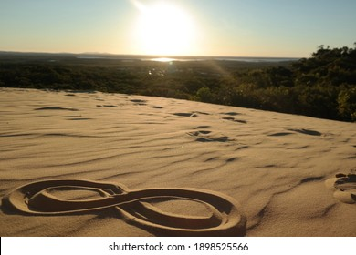 infinity sign painted in the sand on the beach in the desert of vietnam sand dunes of mui ne