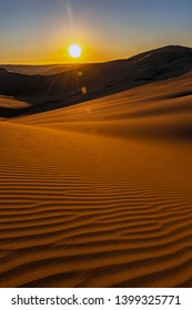 Infinity sunset with beautiful sand ripples, the untouched coastal desert of Peru between Ica and Huacachina, South America.