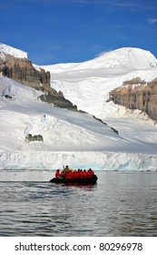 Inflatable boat full of tourists in Antarctica