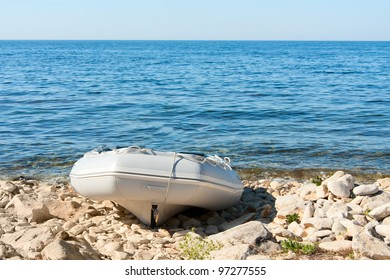 inflatable boat on the sea coast