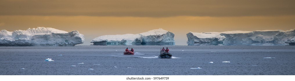Inflatable Boats Explore Icebergs in Antarctica
