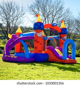 Inflatable castle outdoor at sunny summer day.