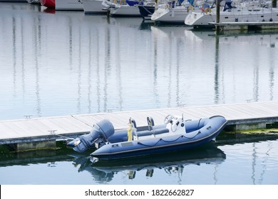 Inflatable dingy life rescue boat moored at marina