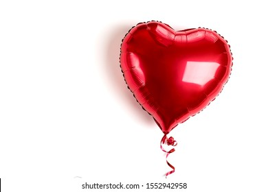 inflatable heart in red color isolated on white background Flat lay Top view Holiday card, Happy Valentine's day concept Love in air