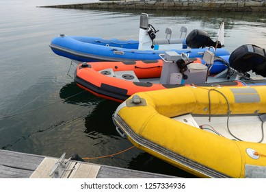 inflatable motor boats on the pier