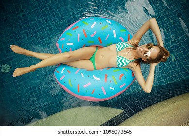 inflatable pool girl hotel girl / rest in a luxury hotel,  beautiful girl in  pool with an inflatable