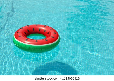 Inflatable ring floating in pool on sunny day