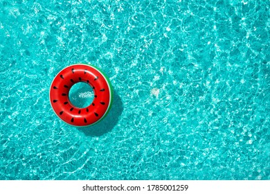Inflatable ring floating in swimming pool, top view with space for text. Summer vacation