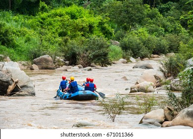 inflatable rubber boat rafting in the creek